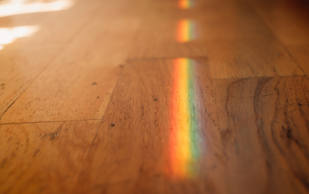 Close up photo of rainbow on wooden floor. Banco de Imagens