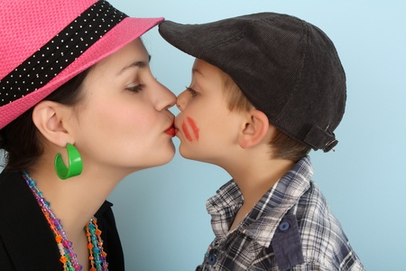 kissing lips: Brunette mother kissing her son on his lips