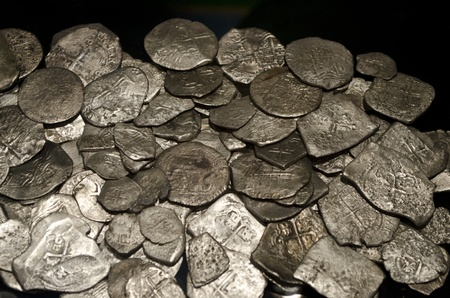 Ancient silver coins in the dark  Treasure photo