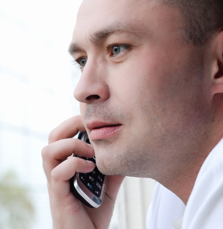 Face of Business man calling and speaking by phone