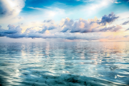 Beautiful clouds above ocean at sunrise