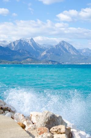 Mountain scenic and splash sea wave Stock Photo