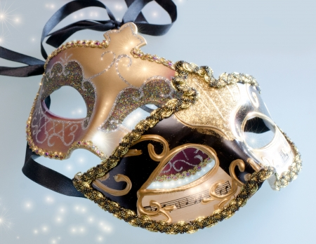 Two carnival Venetian mask with shining glow of stars