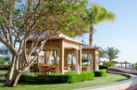 Luxury beach gazebo with white canopy in garden