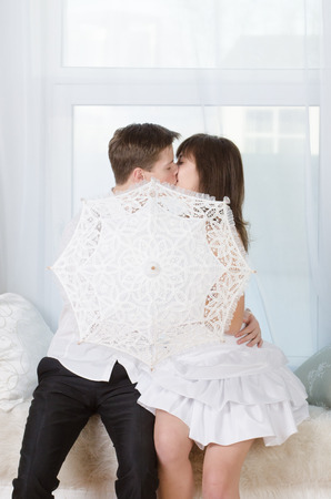 Young happy kissing couple in love photo