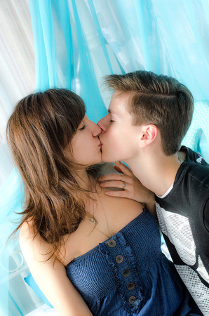 Young happy kissing couple in love