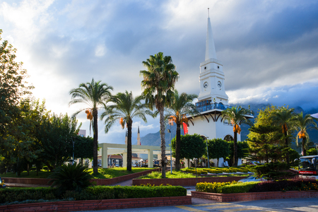 Kemer city tower square with big clock and cafe. And city park. Antalya. Turkey. Lovely place of tourists
