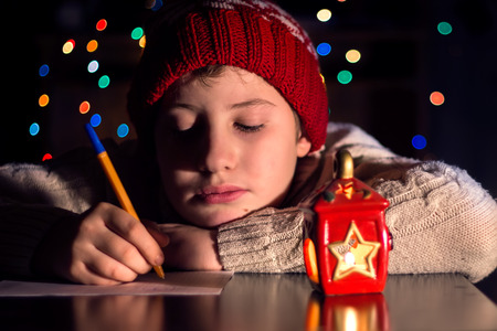 The child writes a letter to Santa Claus photo