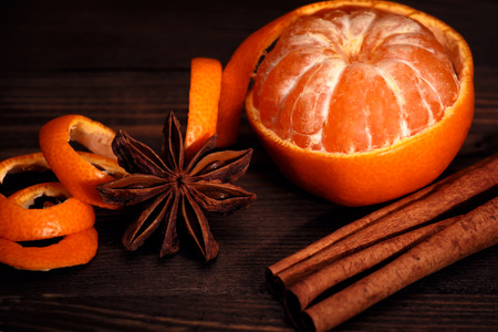 orange peel clove: Mandarin and Christmas spices on wooden background