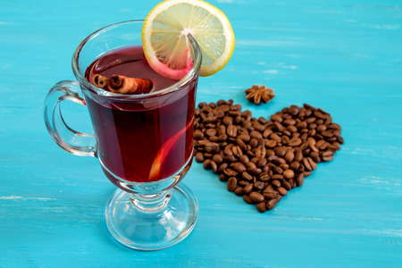 mulled wine spice: Mulled wine and heart on a blue wooden background Stock Photo