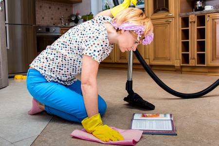 homemaker: Housewife is reading a book and tidying