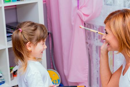 bonny: Mom paint brush nose daughter. Family fun.