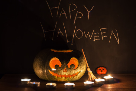 mysticism: Jack-o-lantern and candles. Fantasy about Halloween.