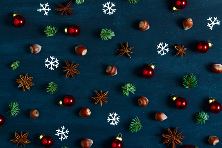 star anise christmas: Background with nuts, balls, fir-tree branches and star anise. Christmas pattern.