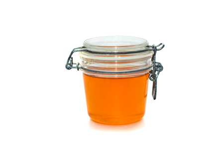 sweet and savoury: Jar with tasty honey. Isolated on white.