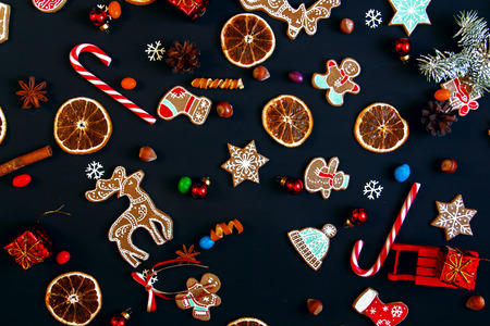valenki: Background with balls, Christmas cookies, snowflakes and oranges. Christmas pattern. Stock Photo