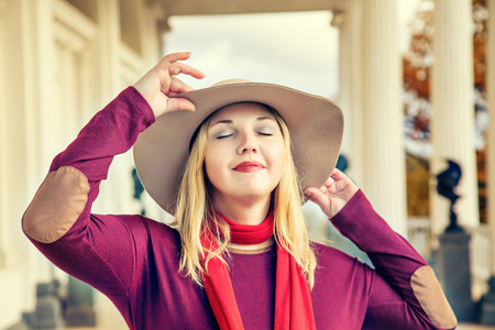 Portrait of beautiful stylish woman in a wide-brimmed hat.