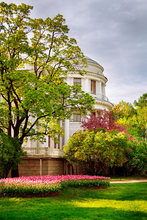Ancient palace in the blossoming spring park, St. Petersburg. Stock Photo