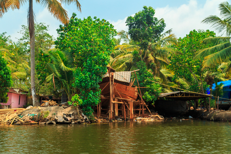 backwater: Building houseboat on the canals of Alleppey, Kerala state, South India. Travel Asia.