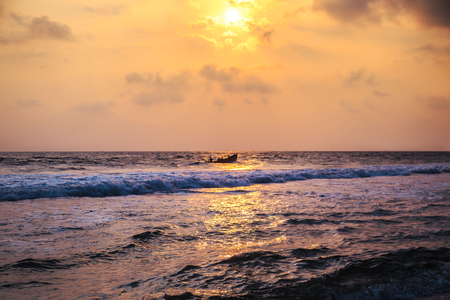 Sunset over the waters of the Indian Ocean. Magnificent seascape.