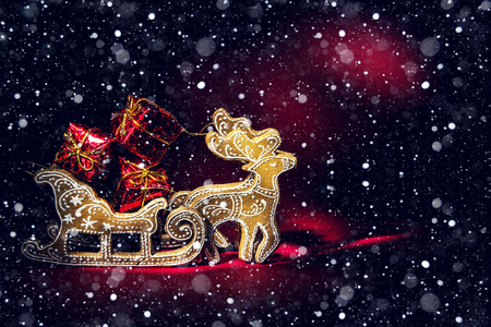 Christmas deer with gifts on a red background. New Year and Christmas decor.