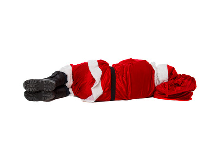 Santa Claus is lying with a bag of gifts. Isolated on white.