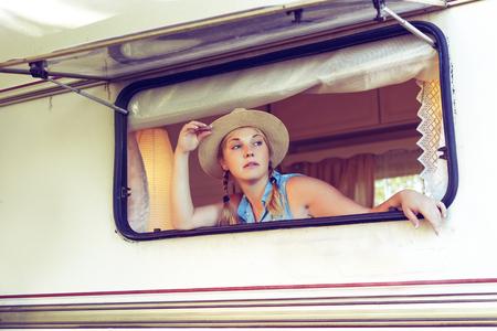 Girl tourist in a camper van in a summer day. Stock fotó