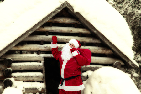 Joyful Santa Claus in his house. The home of Santa Claus at the North Pole. Stock fotó