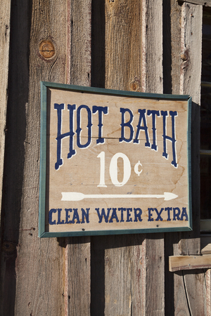 bath: Wooden hot bath sign Stock Photo