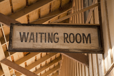 Wooden waiting room sign Stok Fotoğraf