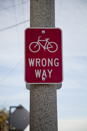 wrong way sign: Red cyclists wrong way sign Stock Photo