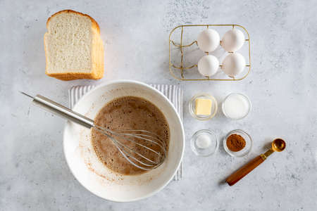 Minimal style flat lay of ingredients for making french toast (or French toast in Dutch) on white gray background, view from above 版權商用圖片