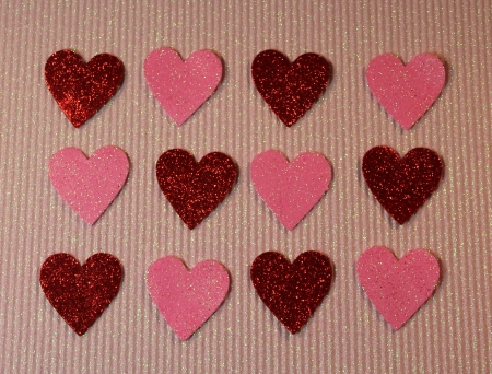 red and pink hearts hearts on pink sparkle Фото со стока