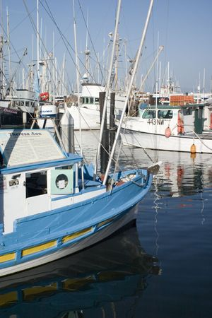 Blue Fishing boat at the marina photo