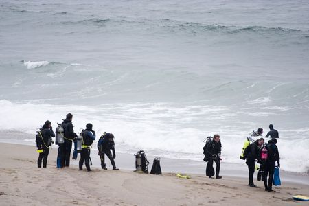 Scuba Divers assembled at the beach for the morning dive photo