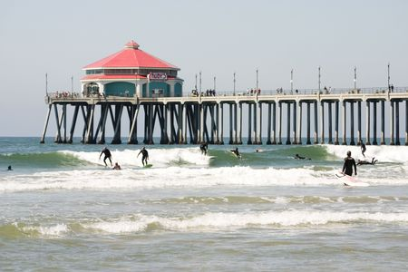 Surfers at the Huntington Beach pier Stock Photo
