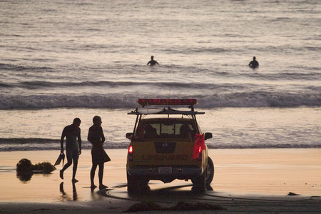 Lifeguard Patrol checking on surfers and swimmers at Venice Beach California photo