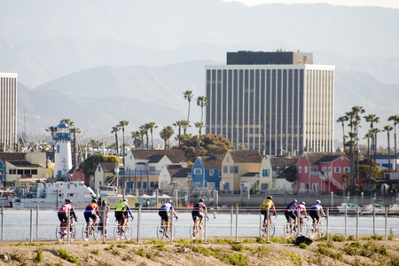 Group of Cyclists in their early morning ride along the harbor in Playa del rey Stock Photo