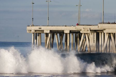roaring sea: Crushing waves at the Venice pier