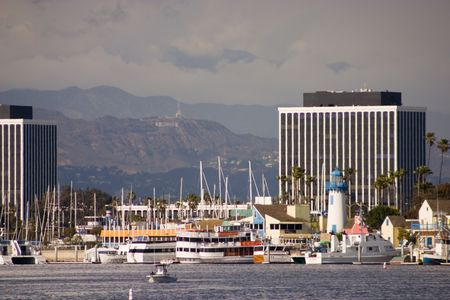 View of Fishermans Village in Marina del rey and its colorful buildings and big yachts