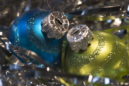 asher: Two Xmas ornaments on a bed of silver gift fillers Stock Photo