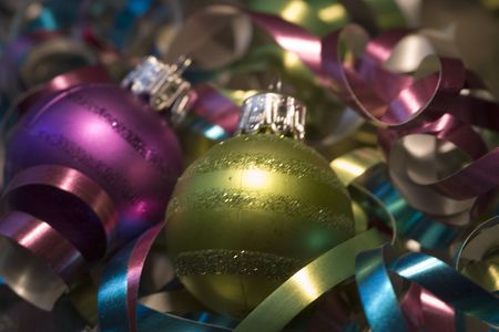 asher: Two Xmas tree ornaments on a bed of curly ribbons Stock Photo
