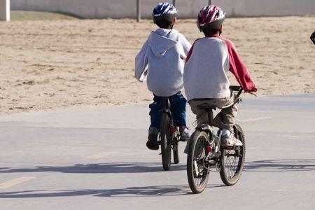 Two boys riding their bikes photo