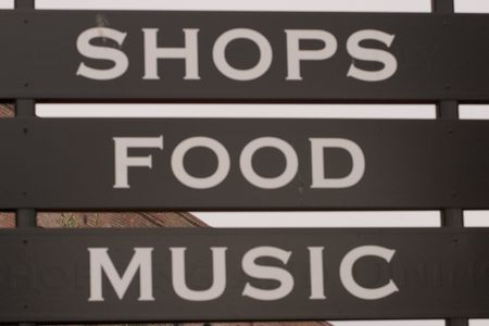 shop sign: Shops, food and music signage