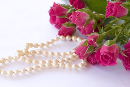 red roses and pearl necklace