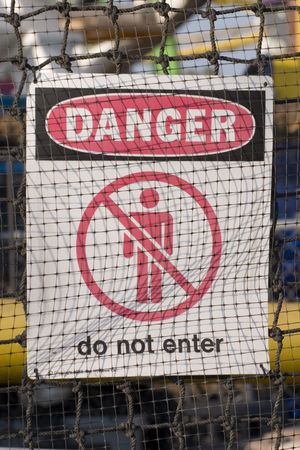 printed material: Danger warning sign at construction site Stock Photo
