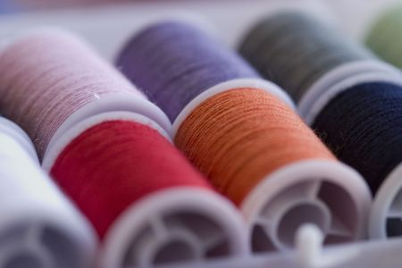 spools of colorful sewing threads