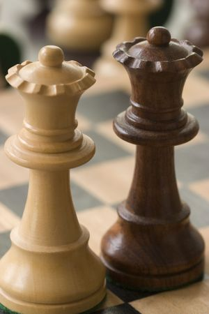 two wooden chess pieces photo