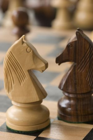 two chess pieces on chess board photo