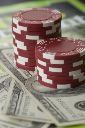 red poker chips and US dollar bills photo